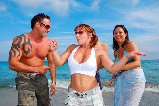 A group of young friends dancing on the beach at Bora Bora; Playa D'en Bossa; Ibiza; 2006 : Stock Photo