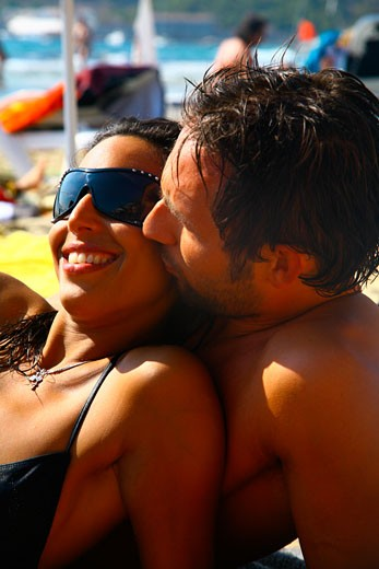 An attractive young couple embracing on the beach; Ibiza 2006 : Stock Photo