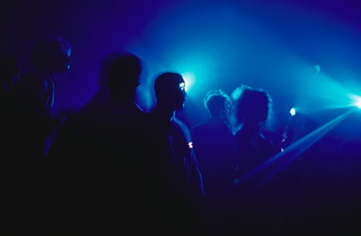Ravers Under Blue Light : Stock Photo