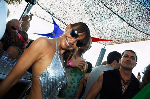 Girl wearing sunglasses and silver dress smiling, Space opening party, Ibiza 2007 : Stock Photo