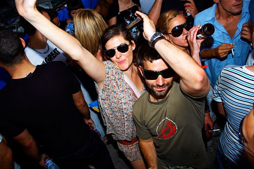 A group of people dancing with their arms up, wearing sunglasses, Space opening party, Ibiza 2007 : Stock Photo