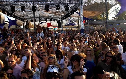 A crowd cheering, Space opening party, Ibiza 2007 : Stock Photo