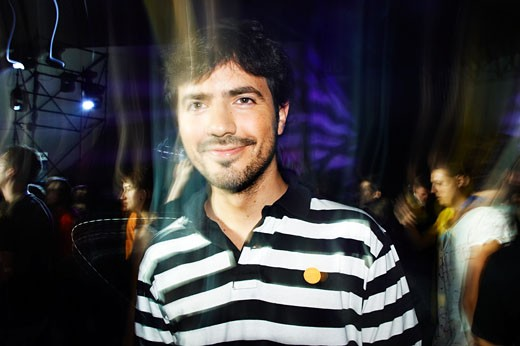 Man smilling at the camera in a nightclub at the Sonar festival, Barcelona, 2007 : Stock Photo