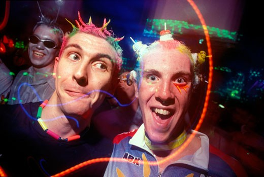 Stock Photo: 4062-3292 Two male clubbers looking into camera with neon hair and wide eyes. Slinky at BIC in Bournmouth 1999.