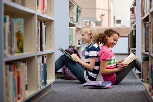 Stock Photo: 4064-216A Middle school students reading in a library