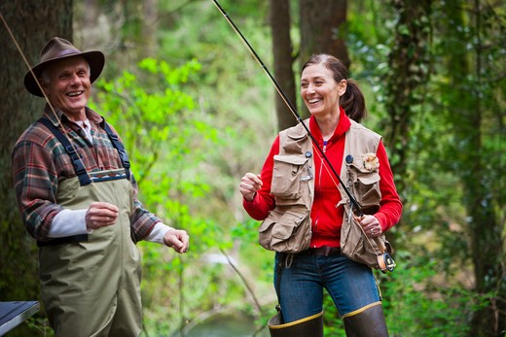 Stock Photo: 4064R-232 USA, Washington, Vancouver, Couple getting ready for fishing