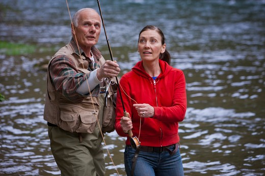 USA, Washington, Vancouver, Couple fishing in river : Stock Photo