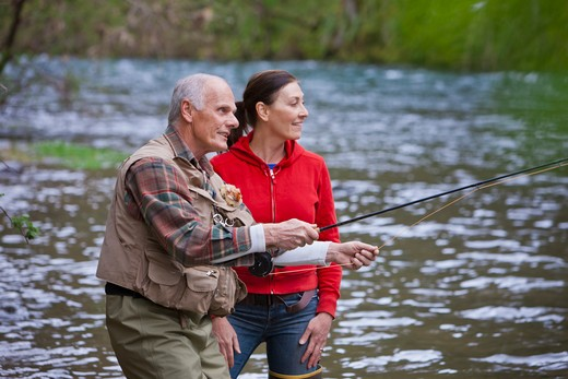 Stock Photo: 4064R-256 USA, Washington, Vancouver, Smiling couple fishing in river