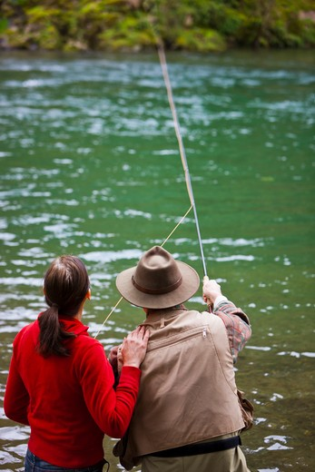 USA, Washington, Vancouver, Rear view of couple fishing in river : Stock Photo