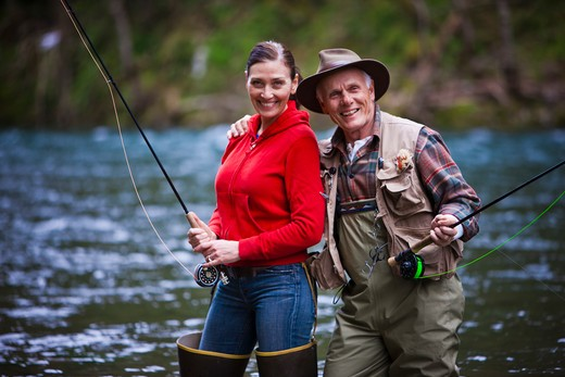 USA, Washington, Vancouver, Portrait of smiling couple fishing in river : Stock Photo
