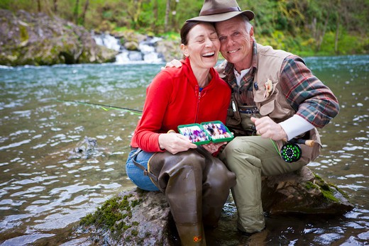 Stock Photo: 4064R-282 USA, Washington, Vancouver, Portrait of smiling couple fishing in river