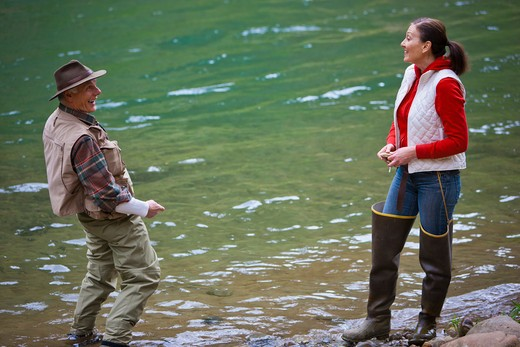 Stock Photo: 4064R-284 USA, Washington, Vancouver, Smiling couple fishing in river