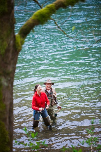 Stock Photo: 4064R-285 USA, Washington, Vancouver, Smiling couple fishing in river
