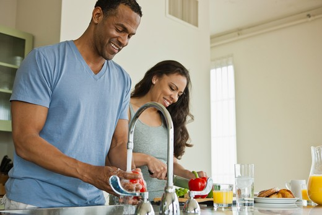 Stock Photo: 4064R-290 Couple making breakfast in loft apartment