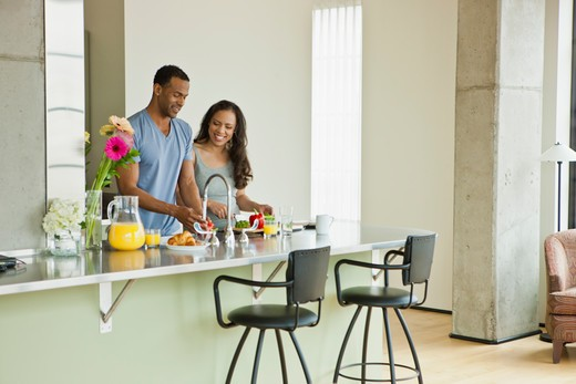 Stock Photo: 4064R-291 Couple making breakfast in loft apartment