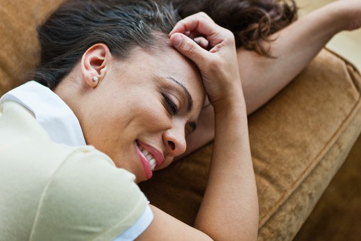 Stock Photo: 4064R-328 Woman relaxing on couch