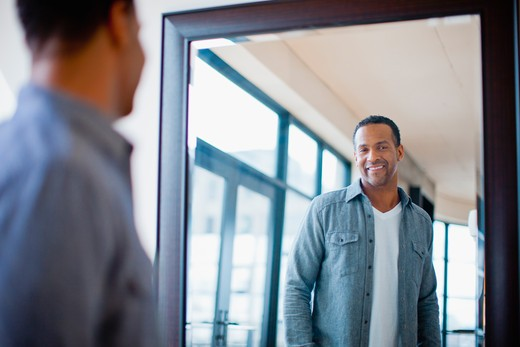 Stock Photo: 4064R-331 Man getting dressed