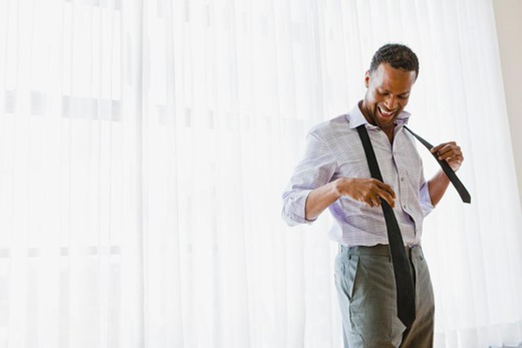 Man getting dressed : Stock Photo
