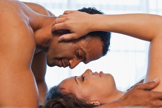 Couple sharing intimate moment : Stock Photo