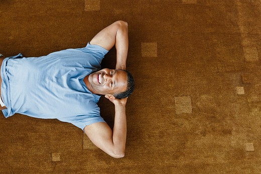 Stock Photo: 4064R-380 Man relaxing on floor in loft apartment