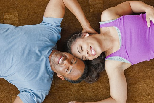Stock Photo: 4064R-381 Couple relaxing on floor