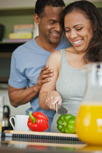 Stock Photo: 4064R-384 Couple making breakfast in loft apartment