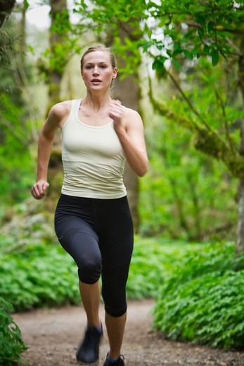 Portland, Oregon, USA, Woman trail running in forest : Stock Photo