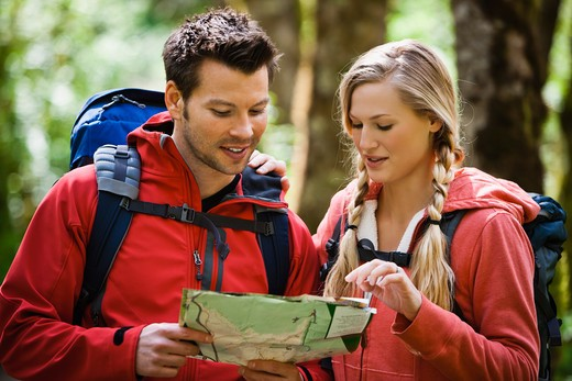 Portland, Oregon, USA, Couple hiking, stopping to reading map : Stock Photo