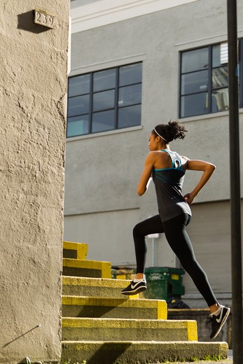 Stock Photo: 4064R-491 Woman jogging up steps