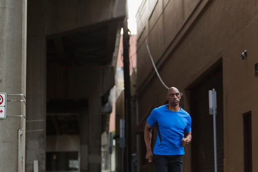 Stock Photo: 4064R-506 Man jogging in street