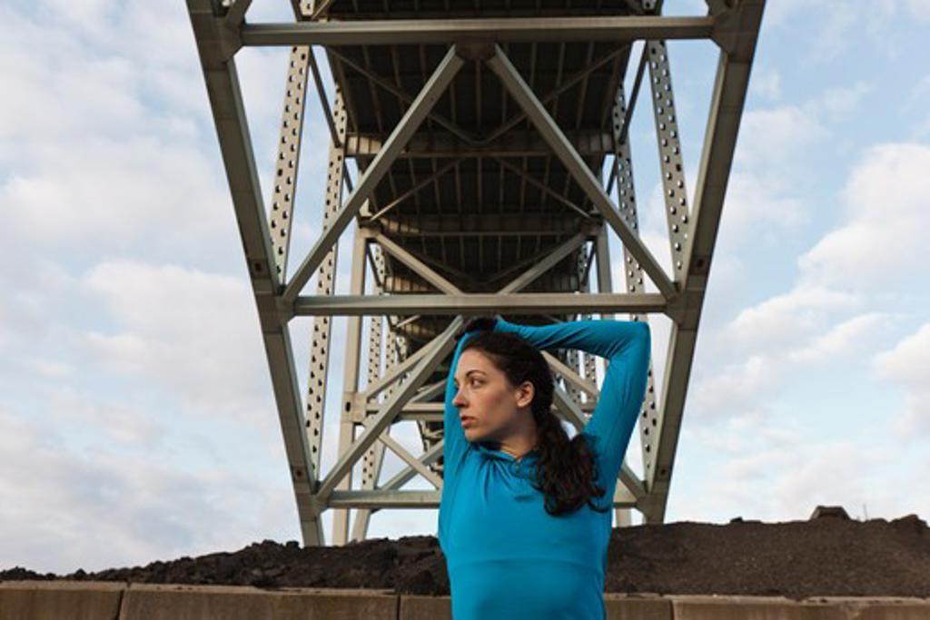 Female urban athlete stretching : Stock Photo