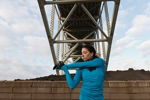 Female urban athlete stretching : Stock Photo