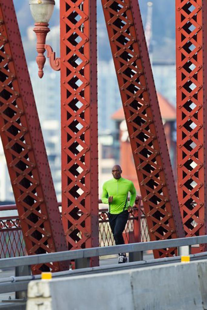 Stock Photo: 4064R-567 Man running along bridge