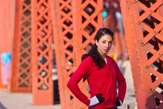 Stock Photo: 4064R-575 Portrait of female runner on bridge