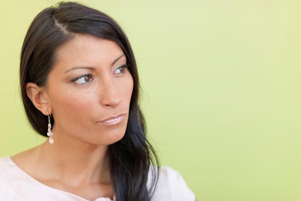 Studio portrait of pensive businesswoman : Stock Photo