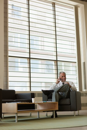 Stock Photo: 4064R-589 Businessman waiting in office lobby