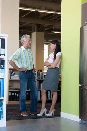 Office workers taking break in office kitchen : Stock Photo