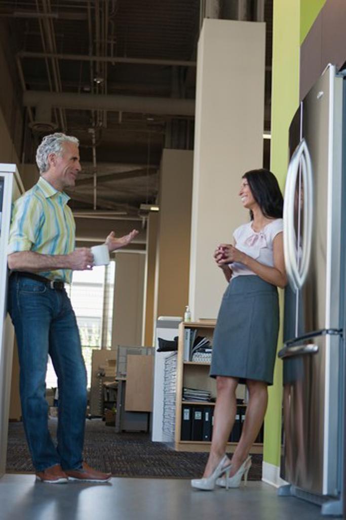 Stock Photo: 4064R-598 Office workers taking break in office kitchen