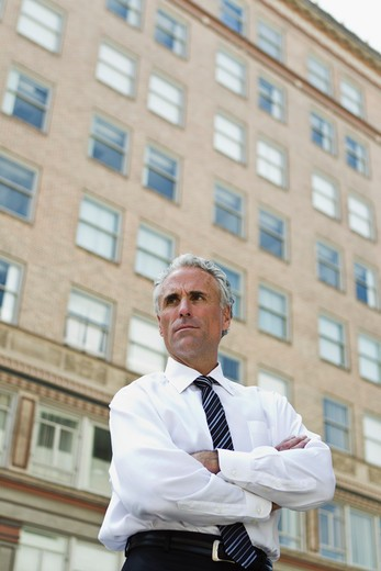 Businessman outside office in city : Stock Photo