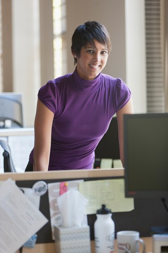 Portrait of businesswoman at desk in office : Stock Photo