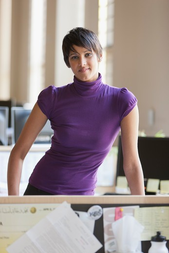 Stock Photo: 4064R-647 Portrait of businesswoman at desk in office