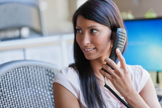 Stock Photo: 4064R-652 Businesswoman answering phone