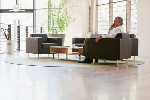 Stock Photo: 4064R-665 Business executive waiting in office lobby