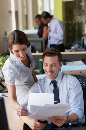 Employees collaborating in office : Stock Photo