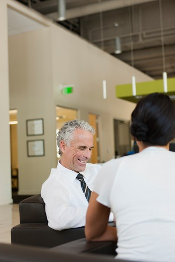 Stock Photo: 4064R-671 Business discussions in office lobby