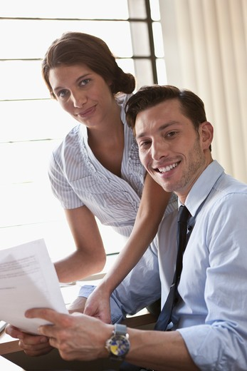 Stock Photo: 4064R-672 Employees collaborating at desk in office