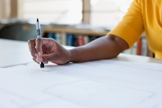 Stock Photo: 4064R-695 Woman working on plans, close-up