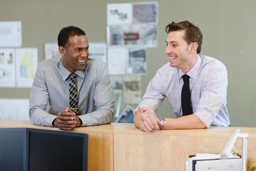 Stock Photo: 4064R-712 Male co-workers hanging out at office