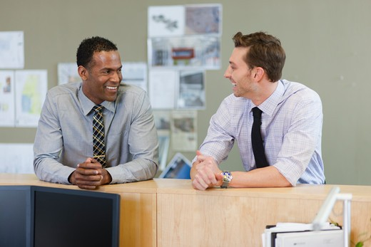 Stock Photo: 4064R-713 Male co-workers hanging out at office