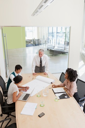 Stock Photo: 4064R-789 Project discussions amongst employees in boardroom